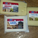 I've tried 2 of these 3 Swiss Cheeses so far and both are quite good. No, they don't have holes.