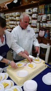Alan Furman of Edibles (in Reston) cutting lemon cake!