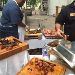 Freshly grilled sausages being served at Del Campo.