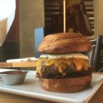 Put an egg on it: brunch burger, with bacon and fries