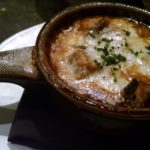 FRENCH ONION SOUP: Enriched with braised beef short rib, gruyère + white cheddar gratin